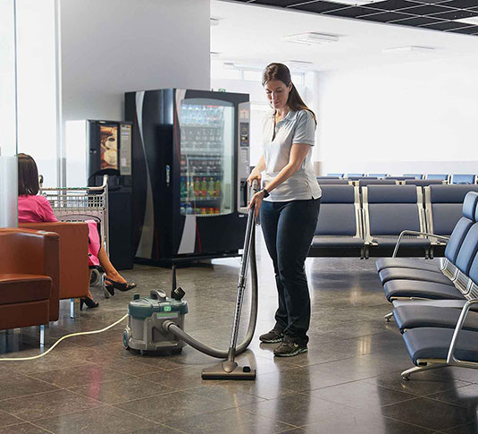 Nobles Tidy-Vac 6 canister vacuuming airport hard floor