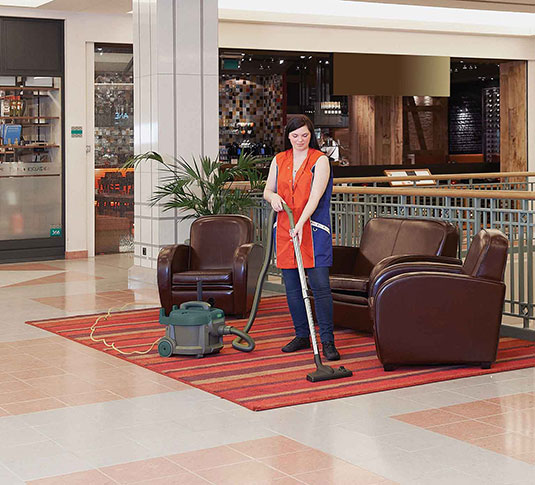 Nobles Tidy-Vac 6 canister vacuuming retail floors
